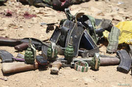 Ammunition used by suspected al Shabaab assailants killed during an attack is displayed outside Somalia's regional government headquarters in the central city of Baidoa, March 12, 2015.