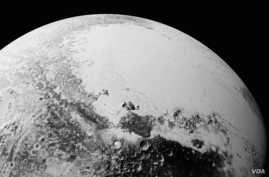 This synthetic perspective view of Pluto, based on the latest high-resolution images to be downlinked from NASA's New Horizons spacecraft, shows what you would see if you were approximately 1,100 miles (1,800 kilometers) above Pluto's equatorial area