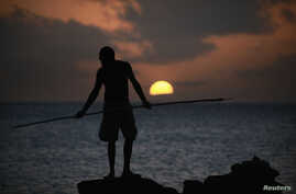 An Aboriginee is seen spear fishing in Australia's Northern Territory in this July 18, 2013, file photo.