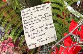 A note to the victims of Friday's mass shooting was placed alongside 50 red paper hearts near the Al Noor mosque in Christchurch, New Zealand, March 18, 2019.