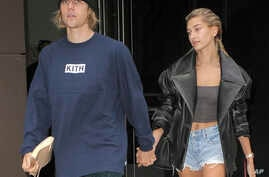 FILE - Justin Bieber and Hailey Baldwin are seen in New York City, Sept. 14, 2018.