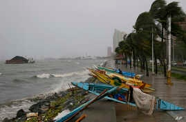 Small fishing boats are placed by the seawall as strong winds and slight rain brought by Typhoon Koppu hit Manila, Philippines, Oct. 18, 2015.