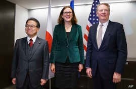 From left, Japanese Minister of Economy, Trade and Industry, Hiroshige Seko, European Commissioner for Trade, Cecilia Malmstrom, and U.S. Trade Representative Robert Lighthizer, pose for media before meeting in Washington, Jan. 9, 2019.
