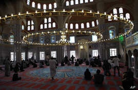 FILE - The interior of the Nizamiye Mosque in Midrand  north of Johannesburg, South Africa.