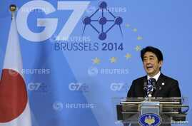 Japan's Prime Minister Shinzo Abe holds a news conference at the end of the G7 summit at the European Council headquarters in Brussels, June 5, 2014.