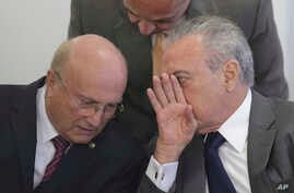 Brazil's President Michel Temer (R) speaks with his Justice Minister Osmar Serraglio (L) during a ceremony at the Planalto presidential palace, in Brasilia, Brazil, April 12, 2017.