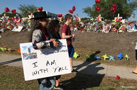 People arrive at the Marjory Stoneman Douglas High School before a planned National School Walkout to protest gun violence in Parkland, Florida, March 14, 2018.