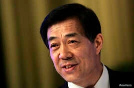 China's former Chongqing Municipality Communist Party Secretary Bo Xilai attends a session of the Chinese People's Political Consultative Conference (CPPCC) of the Chongqing Municipal Committee, in Chongqing municipality, Jan. 26, 2008.