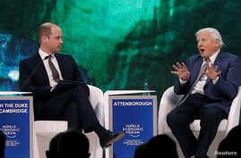 FILE - Britain's Prince William, Duke of Cambridge interviews naturalist Sir David Attenborough during the World Economic Forum (WEF) annual meeting in Davos, Switzerland, Jan. 22, 2019.