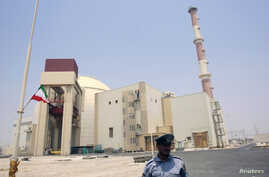 File - A security official stands in front of the Bushehr nuclear reactor, 1,200 km (746 miles) south of Tehran, August 21, 2010.