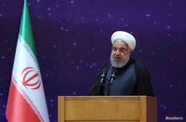 """In this photo released by the office of the Iranian Presidency, President Hassan Rouhani speaks in a ceremony to mark """"National Nuclear Day,"""" dedicated to the country's achievements in nuclear technology, April 9, 2018."""
