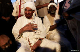 FILE - Sudanese leading opposition figure Sadiq al-Mahdi meets his supporters after he returned from nearly a year in self-imposed exile in Khartoum, Sudan, Dec. 19, 2018.