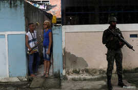 An armed forces member patrols during an operation against drug dealers in Vila Alianca slum, in Rio de Janeiro, Feb. 27, 2018.