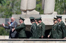 U.S. Secretary of Defence James Mattis gestures next to Brazilian militaries during a visit to the Monument to the Dead of World War II in Rio de Janeiro, Brazil, Aug.14, 2018.