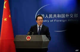 China's Foreign Ministry spokesman Hong Lei is seen during a daily briefing at the ministry in Beijing, China, April 5, 2016. Speaking on Sandy Phan Gillis' case, Hong has called for China's judicial sovereignty to be respected.