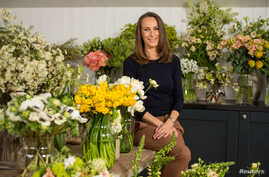 Florist Philippa Craddock, who has been chosen to create the floral displays for the wedding of Prince Harry and Meghan Markle, poses for a photograph in her studio in London, March 29, 2018.