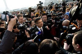 U.S. Ambassador to China Gary Locke, center, is mobbed by journalists as he attends the opening session of the annual National People's Congress at the Great Hall of the People in Beijing, China, Mar. 5, 2013.