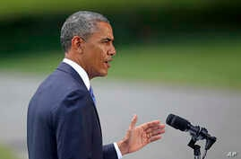 President Barack Obama talks about his administration's response to a growing insurgency foothold in Iraq, June 13, 2014, on the South Lawn of the White House.