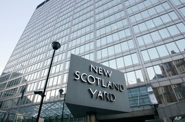 FILE - The headquarters building of the New Scotland Yard is seen in London.