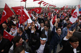 Supporters of Devlet Bahceli, the leader of the Nationalist Movement Party, (MHP), chant slogans as he addresses a rally ahead of the Nov. 1 general elections, in Istanbul, Oct. 18, 2015.