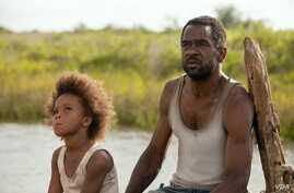 """Quvenzhane Wallis as """"Hushpuppy"""" and Dwight Henry as """"Wink"""" on the set of Beasts of The Southern Wild (Photo: Fox Searchlight / Mary Cybulski)"""