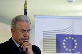 "EU Migration Commissioner Dimitris Avramopoulos, shown at a news conference after a meeting with local officials in Athens on June 12, 2015, says that ""now is the moment for actions"" on migrant redistribution. ""We should not waste any more time."""