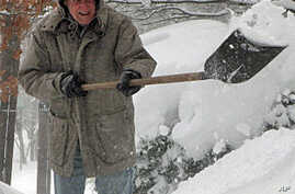 Americans in northeastern US struggled to dig out from blizzards that hit the region