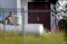FILE - Bullet holes were marked by police at the front of the building as law enforcement officials continue to investigate the scene of a shooting at the First Baptist Church of Sutherland Springs in Sutherland Springs, Texas, Nov. 7, 2017.