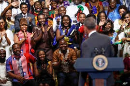 "President Barack Obama is welcomed by the Young African Leaders Initiative as they shout ""happy birthday,"" in Washington, Aug. 3, 2016."