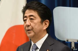 Japanese Prime Minister Shinzo Abe delivers a war anniversary statement that neighbouring nations will scrutinise for signs of sufficient remorse over Tokyo's past militarism at his official residence in Tokyo, August 14, 2015.