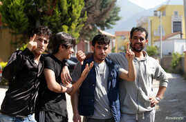 Syrian migrants are pictured in front of the National Reception Center For Asylum Seekers in Tirana, Albania, June 6, 2018.