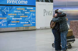 Abdullah Alghazali, right, hugs his 13-year-old son Ali Abdullah Alghazali after the Yemeni boy stepped out of an arrival entrance at John F. Kennedy International Airport in New York, Feb. 5, 2017.