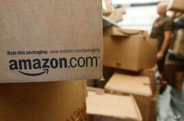 FILE- An Amazon.com package awaits delivery from UPS in Palo Alto, California, Oct. 18, 2010. With its stock price rising above $1,000, the e-commerce giant now has a market value of $478 billion, double that of rival Wal-Mart.