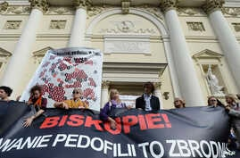Protesters hold a map of Poland with 255 documented and alleged cases of sexual abuse of minors by the country's Catholic priests as they march in Warsaw, Poland, Oct. 7, 2018.
