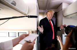 U.S. President Donald Trump speaks to the press aboard Air Force One en route to Bedminster, New Jersey, from Joint Base Andrews, Maryland, June 29, 2018.