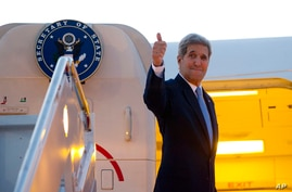 U.S. Secretary of State John Kerry gives a thumbs-up as he boards his aircraft from Andrews Air Force Base, Md., for a flight to Havana, Aug. 14, 2015.
