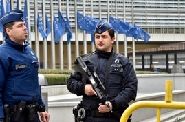 Police patrol the EU commission building, after  a bomb exploded nearby, at the subway in Brussels, Belgium, March 22, 2016.