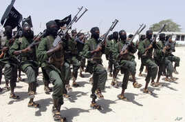FILE - hundreds of newly trained al-Shabab fighters perform military exercises in the Lafofe area some 18 km south of Mogadishu, in Somalia.