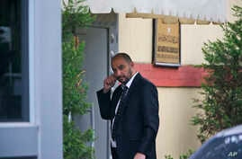 "A security guard walks outside Saudi Arabia's consulate in Istanbul, Oct. 20, 2018. Saudi Arabia claims Saudi journalist Jamal Khashoggi died in a ""fistfight"" in the consulate, finally admitting that the writer had been slain at its diplomatic post."