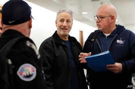 Entertainer and activist Jon Stewart, center, speaks with members of the FealGood Foundation as they arrive on Capitol Hill to speak with lawmakers about the compensation fund for victims of 9/11, Feb. 25, 2019, on Capitol Hill in Washington.
