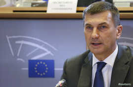 FILE - Andrus Ansip addresses the European Parliament's Committee on the Internal Market and Consumer Protection at the EU Parliament in Brussels, Oct. 6, 2014.