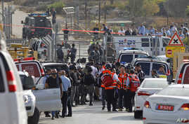 Israeli security forces and emergency teams gather at the scene of an attack at the entrance to the West Bank settlement of Har Adar, Sept. 26, 2017.