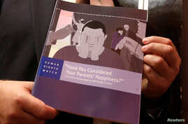 Boris Dittrich, advocacy director of the lesbian, gay bisexual, and transgender (LGBT) rights program at Human Rights Watch, poses with a report in Hong Kong, China, Nov. 15, 2017.