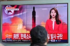 "A man watches a TV news program reporting about North Korea's missile launch in Seoul, South Korea, Feb. 12, 2017. The letters read ""The ruling and the opposition parties denounce North Korea's missile launch."""