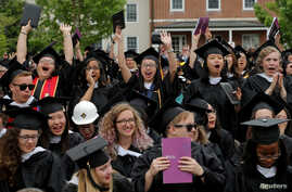 FILE - Graduating seniors react during Commencement ceremonies at Smith College in Northampton, Massachusetts, May 21, 2017