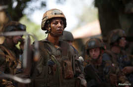FILE - French soldiers stand in front of protesters demonstrating against French troops in Bambari, Central African Republic.