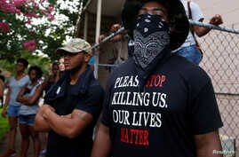 A demonstrator stands during protests in Baton Rouge, Louisiana, U.S., July 10, 2016.