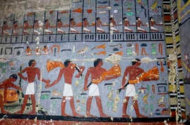 This photo released April 2, 2019, by the Egyptian Ministry of Antiquities, shows pharaonic paintings in the tomb of a noble from the time of one of the earliest pharaonic dynasties, in Saqqara, Giza, Egypt.