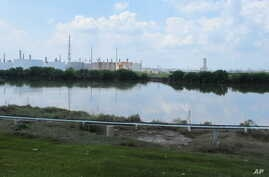 This Saturday, Sept. 2, 2017, photo shows the heavily polluted Patrick Bayou in the Houston Ship Channel that was flooded during Tropical Storm Harvey in Houston.  The bayou, which sits next to a chemical plant in an intensely industrial area of Hous
