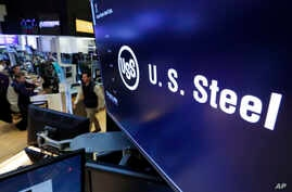 FILE - The logo for U.S. Steel appears on a screen above the trading floor of the New York Stock Exchange.